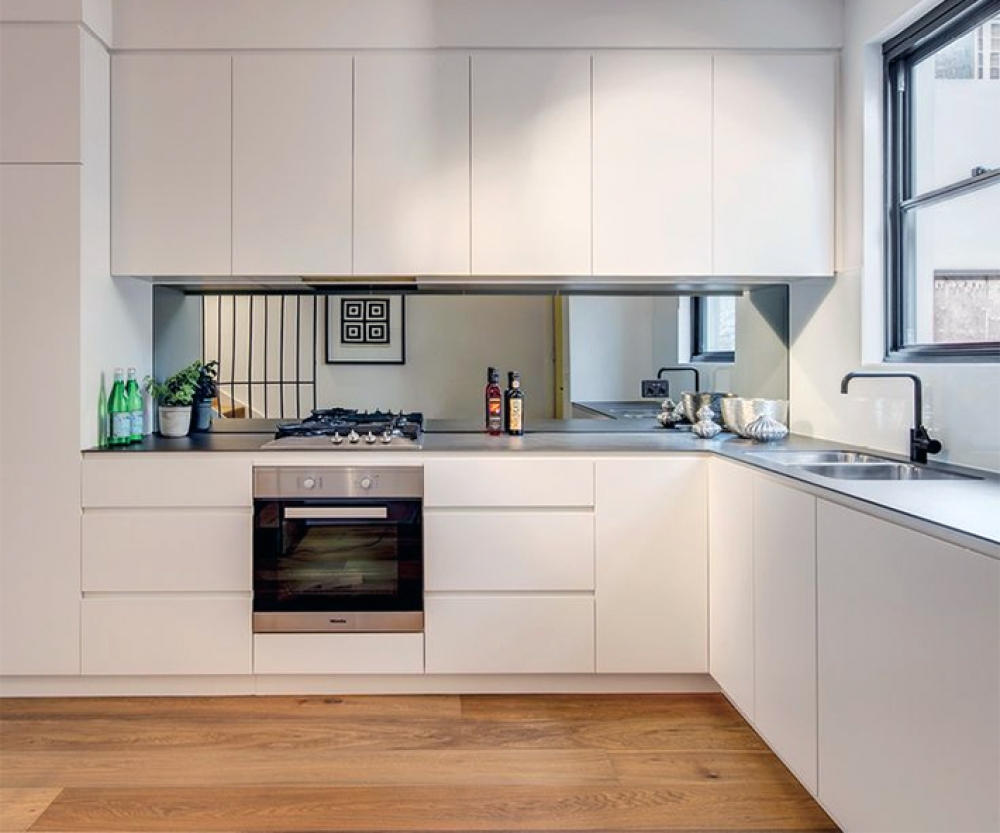 L-shaped white kitchen